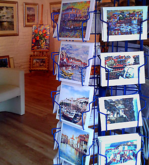 Tas's cards in a rotary frame, with the gallery in the background
